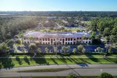 Bird eye view of Hodges University building, blue skies and trees around the facility